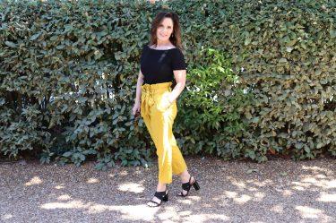 Beth Ferguson wearing paper bag waist linen slacks