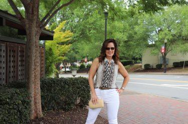 woman wearing snakeskin blouse