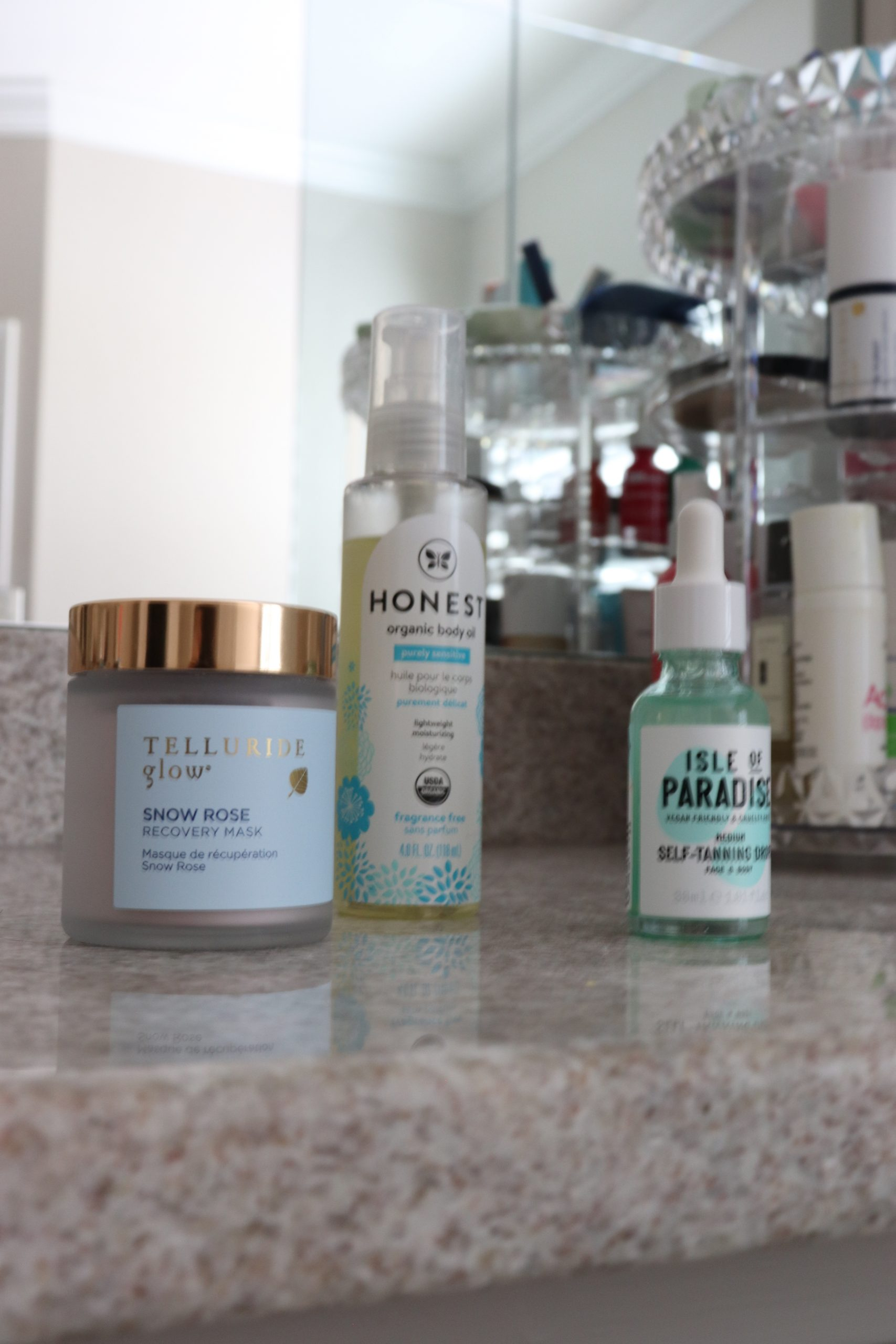 three bottles of clean beauty products sitting on a counter